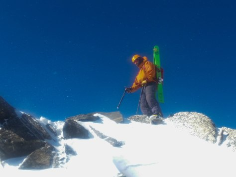 Tristen battling the wind on the summit.